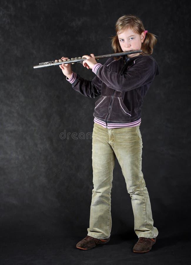 Attraktiver junges Mädchen Flautist. stockfoto
