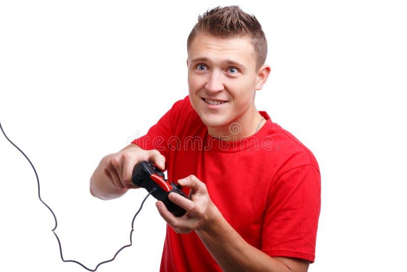 Attraktiver Kerl mit einem Steuerknüppel in den Händen auf einem Weiß lokalisierte Hintergrund stockfotografie