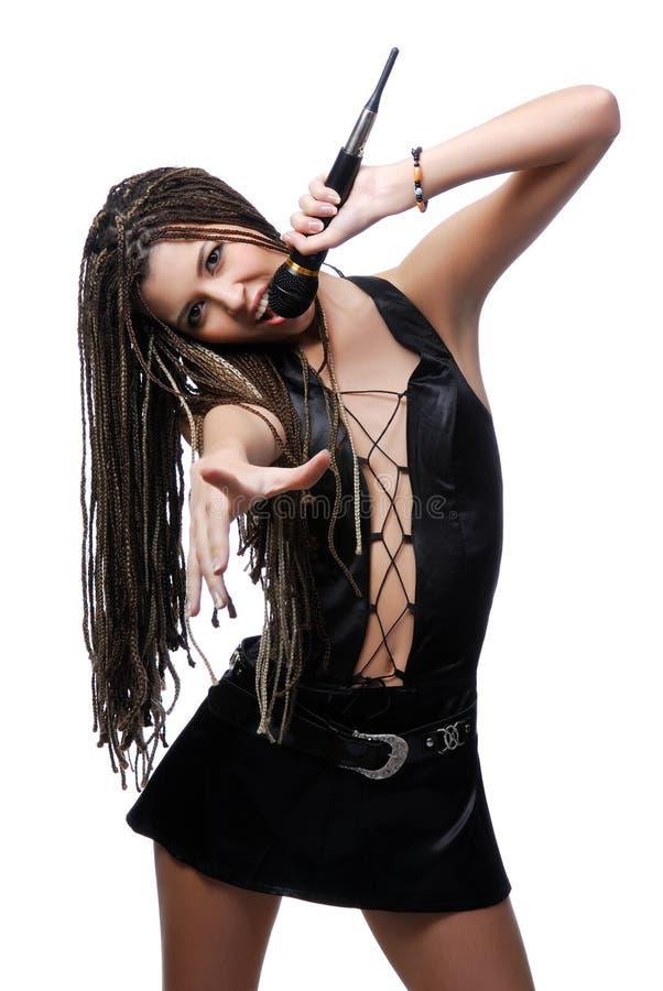 attraktivt sångarekvinnabarn arkivfoton