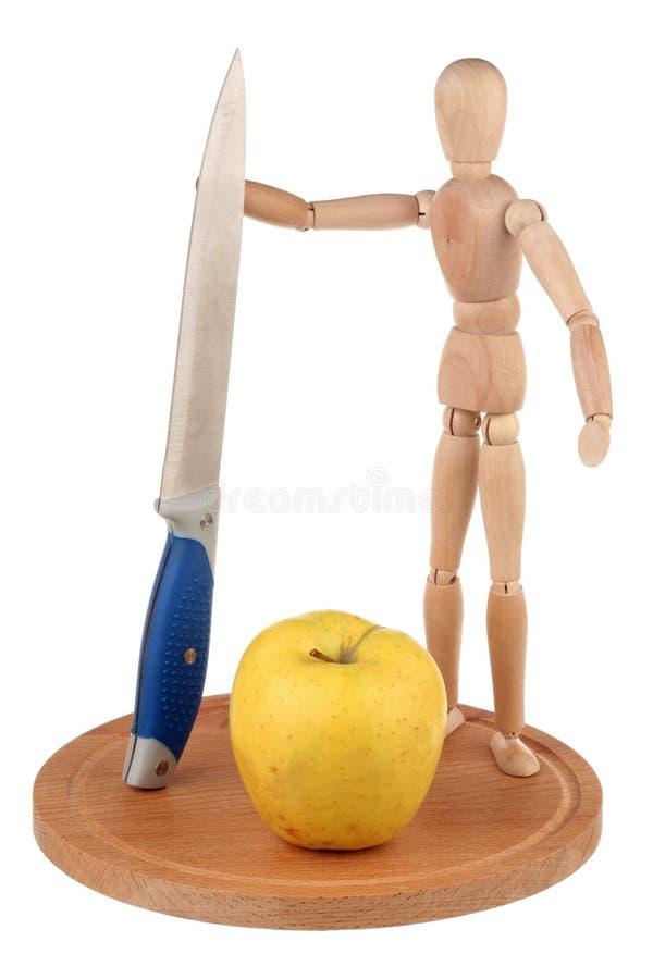 Attrappe, Messer und Apfel stockfotos