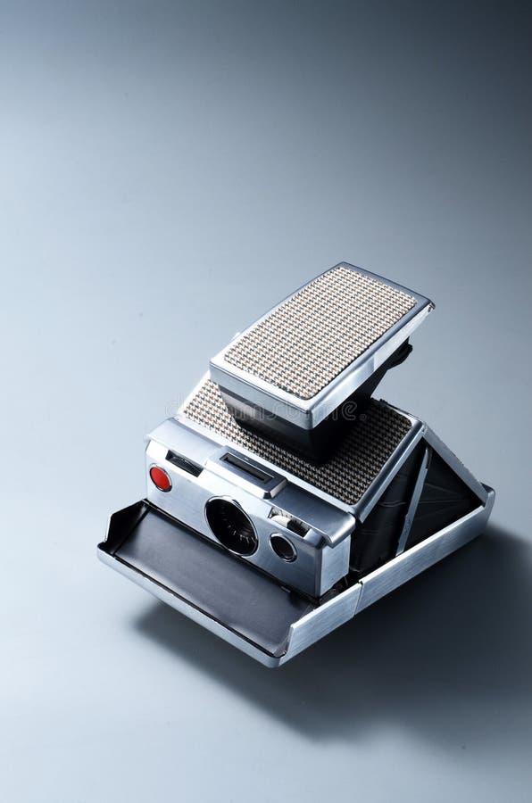 Attrezzatura d'annata del classico della polaroid sx-70 della macchina fotografica istantanea fotografie stock libere da diritti