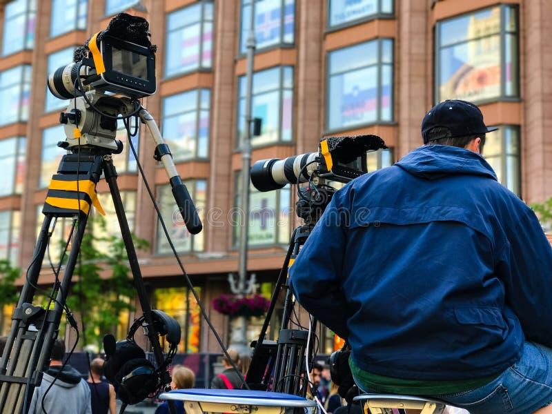 Attrezzatura professionale della videocamera portatile video fotografia stock