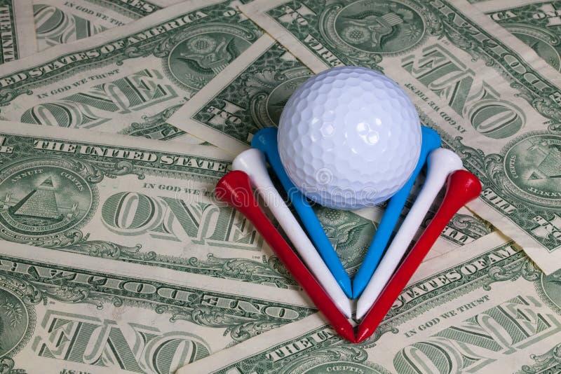 Attrezzature di golf e soldi degli Stati Uniti fotografia stock libera da diritti