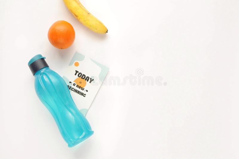 Attributes of a healthy lifestyle: food, sports equipment on white background with motivated phrase. Flat view with copy space. royalty free stock image