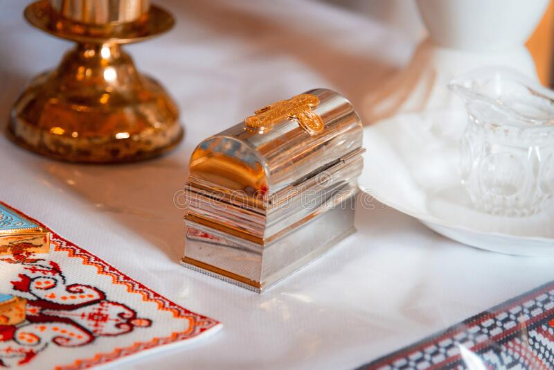 Attributes of the Orthodox priest for baptism, the golden box of peace. Baptism font. Film noise. The Sacrament of Baptism. Attributes of the Orthodox priest for royalty free stock photography
