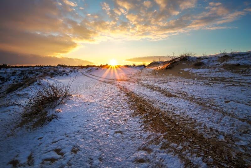 ATV auto sport track at winter. Wheel tracks on snow royalty free stock image