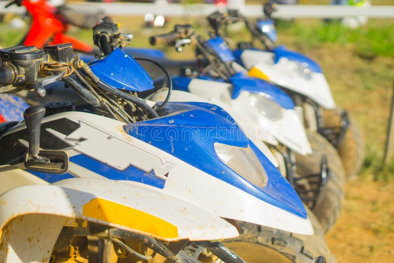 ATV blue car parked at the racetrack. stock images