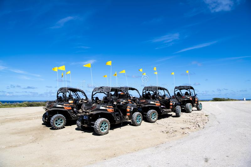 All-terrain vehicles in Aruba. ATV cars, quads, four wheeler, fun vehicles for rent in Aruba, Caribbean Sea, to drive off the beaten path royalty free stock images