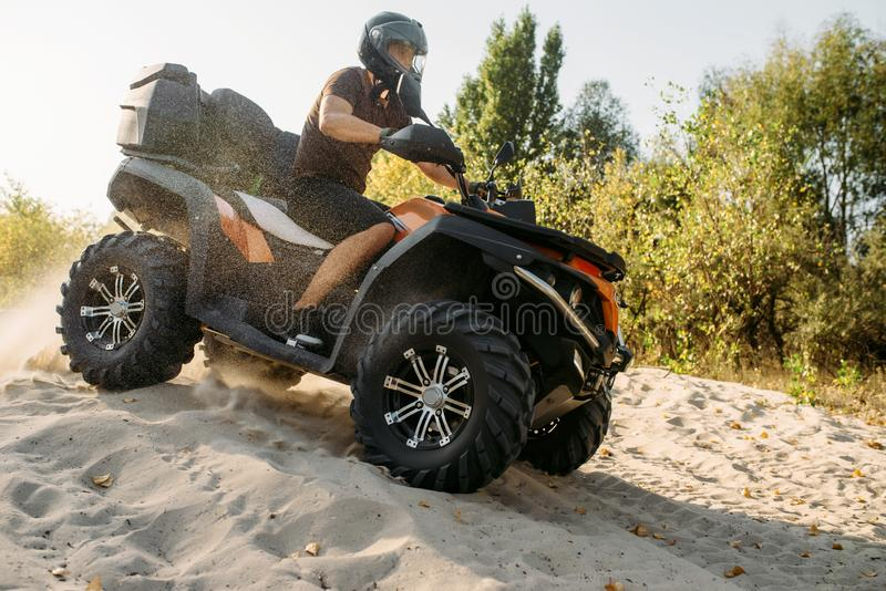 Atv freeriding in sand quarry, extreme sport stock photo