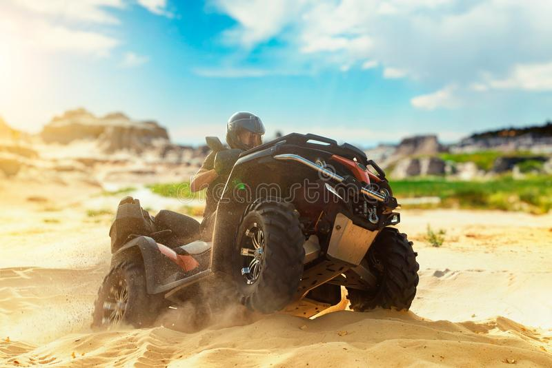 Atv freeriding in sand quarry, extreme sport royalty free stock photos