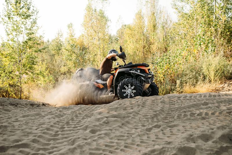 Atv freeriding in sand quarry, extreme sport stock photos