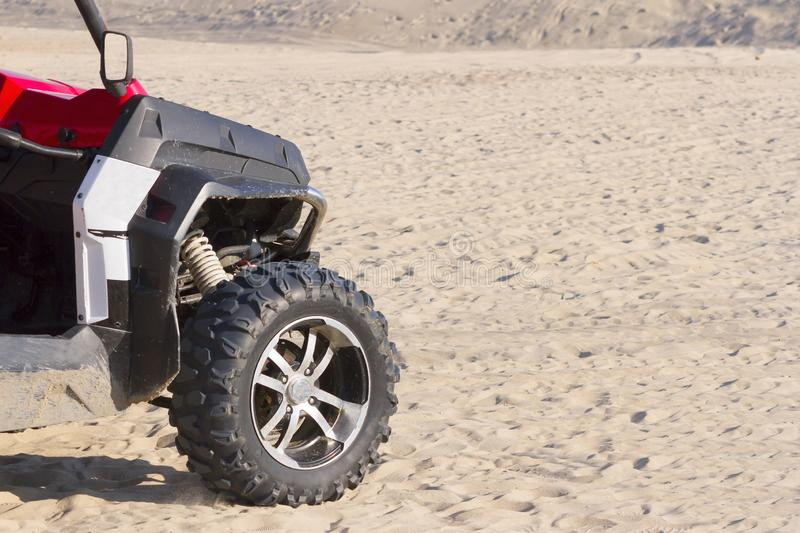 The ATV goes on desert sands to clear day. The ATV goes on desert sands to clear sunny day stock image