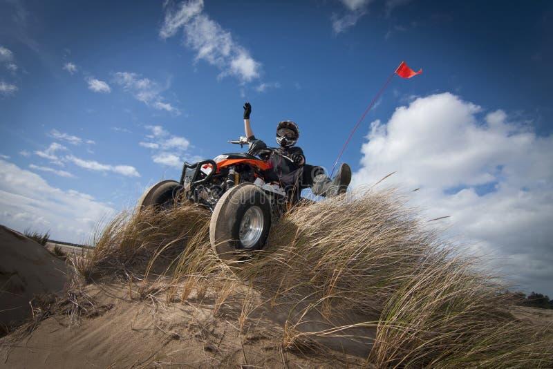 ATV on grassy sand dune royalty free stock images