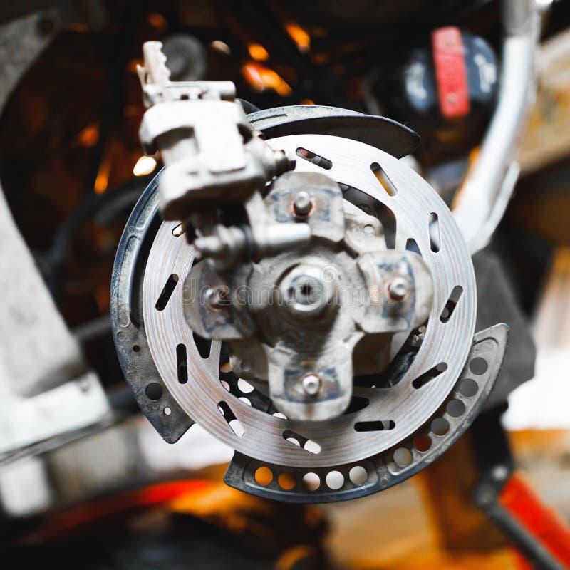 ATV hydraulic disc brake caliper system. Close-up view stock photos