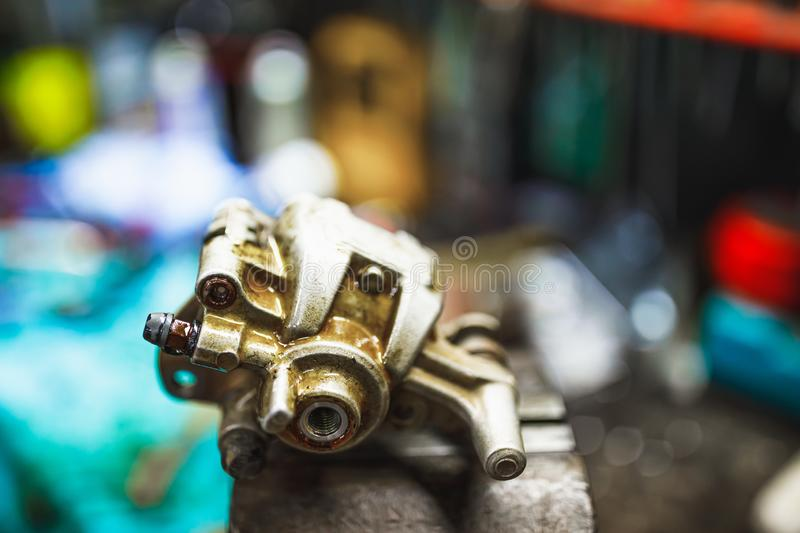 ATV hydraulic disc brake caliper system repair in old garage. Close-up view stock images
