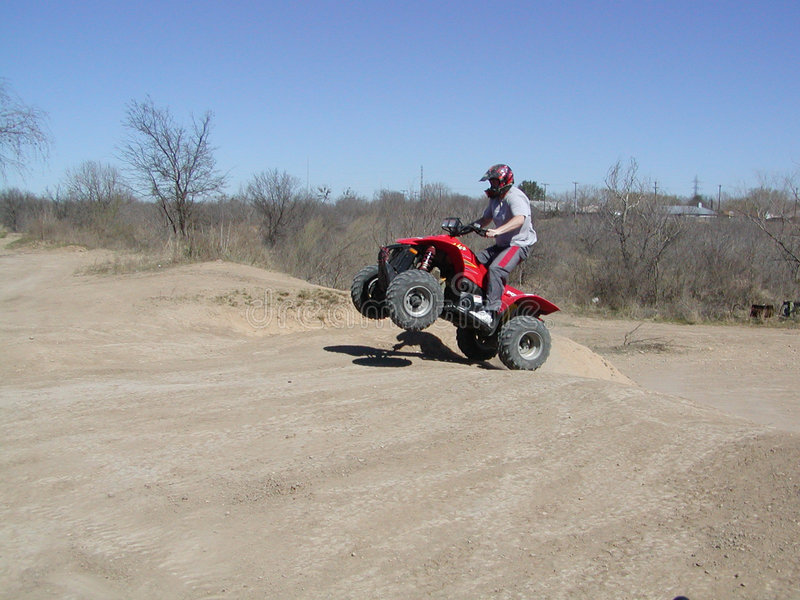Download ATV Jump Shot stock photo. Image of tracks, jump, wheeler - 190340