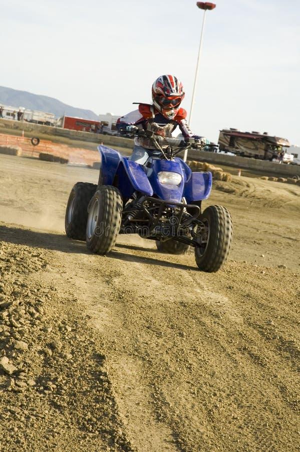 ATV racer on dirt track stock photos