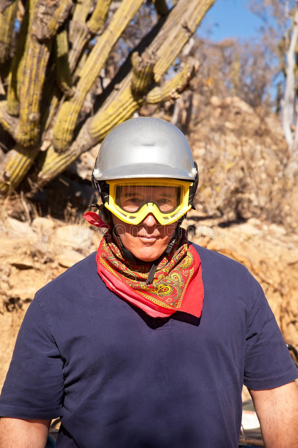 ATV Rider. Adult male driver of an ATV, wearing safety equipment stock photo