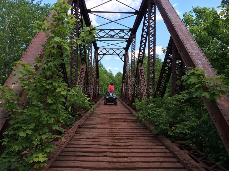 ATV rider on bridge stock image