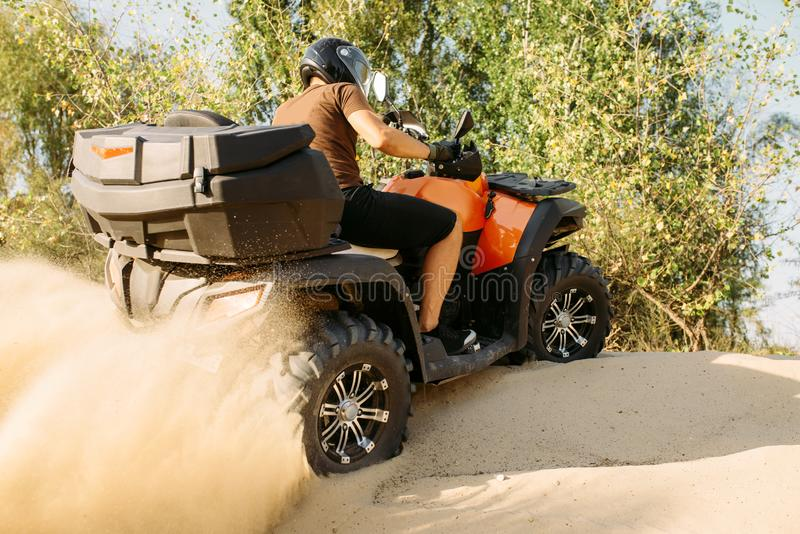 Atv riding in action, sand quarry on background stock photo