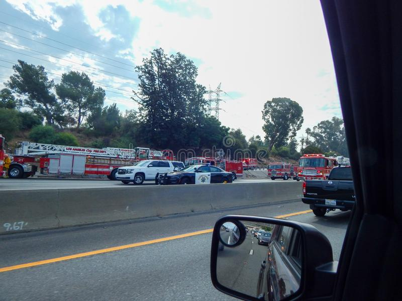 Rescue Vehicles Line the Freeway during accident of overturned truck on 5 Freeway in Los Angeles. Atwater Village, California / United States -  August 7, 2019 stock image