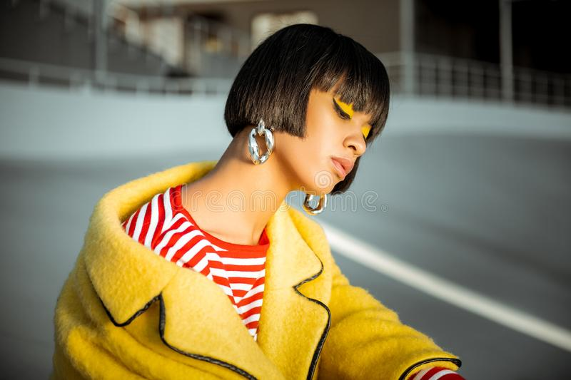 Atypical African American canting her head and showing neck. Looking uninterested. Atypical African American canting her head and showing her long silky neck royalty free stock image