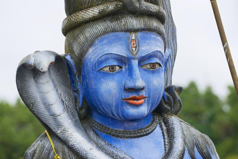 Außendetail der Shiva-Statue an hindischem Tempel Ganga Talao (großartiges Bassin), Mauritius stockfotos