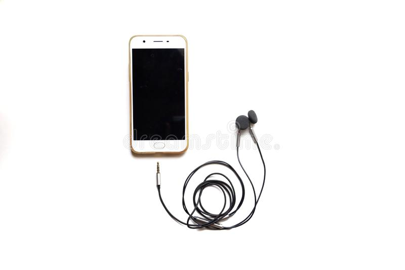 Au foyer sélectif un téléphone portable avec un câble d'écouteur images libres de droits