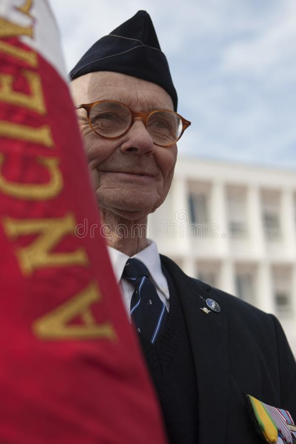Aubagne, France. May 11, 2012. Portrait of a veteran of the French foreign legion with the banner of veterans . royalty free stock image