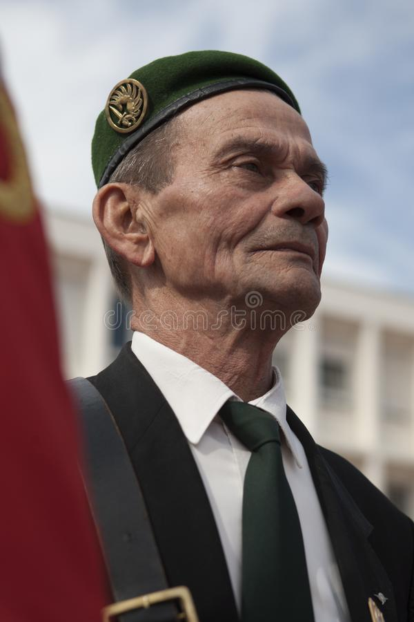 Aubagne, France. May 11, 2012. Portrait of a veteran of the French foreign legion with the banner of veterans . stock image