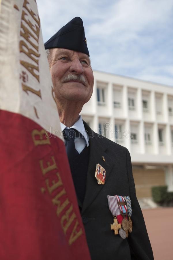 Aubagne, France. May 11, 2012. Portrait of a veteran of the French foreign legion with the banner of veterans . stock photo