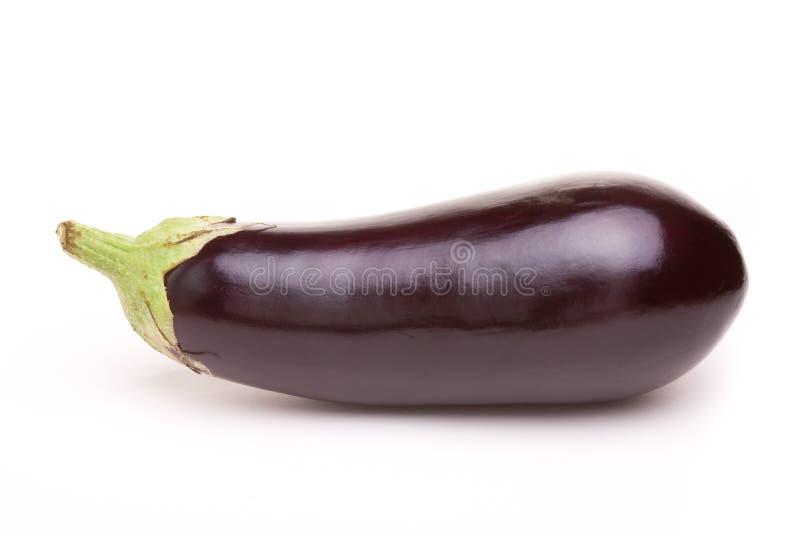 Aubergine. Large dark shiny purple Aubergine isolated against white background royalty free stock photography
