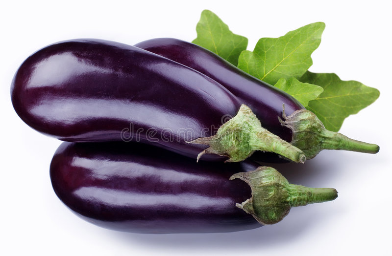 Aubergine. Three aubergine are on a white background royalty free stock photography