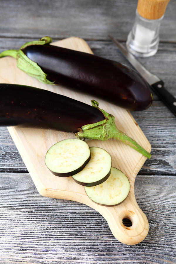 Aubergine on a board. Vegetable stock images