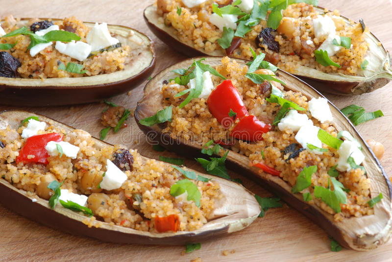 Aubergine with couscous. Aubergine filled with couscous and feta cheese stock photography