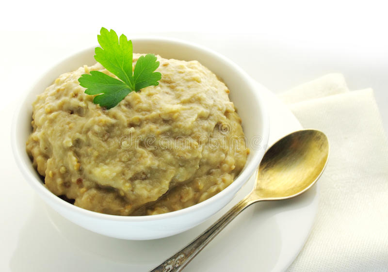 Aubergine paste. In a bowl stock photography