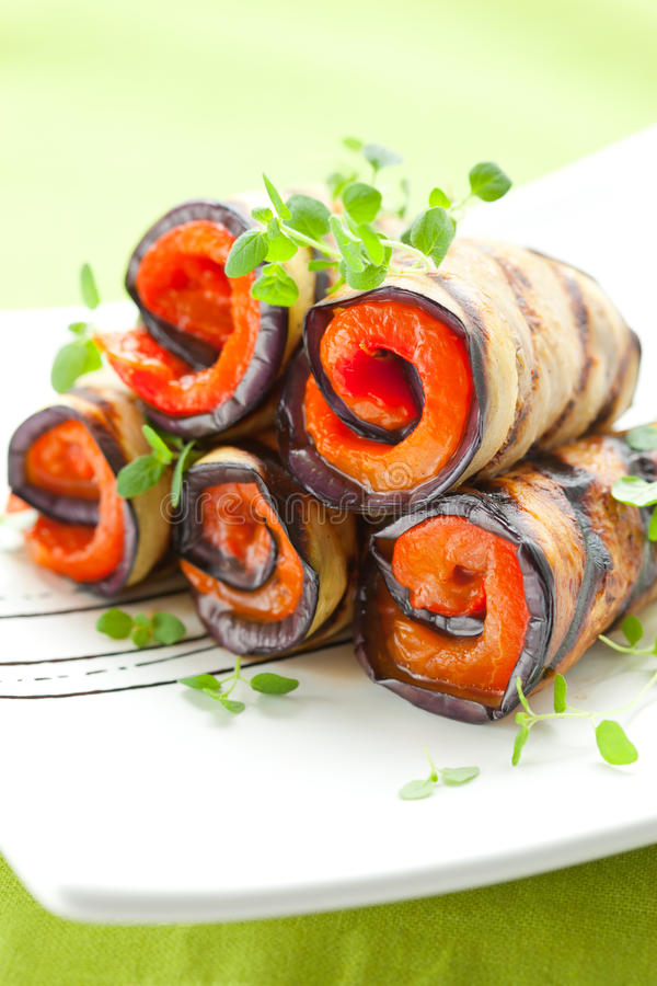 Aubergine rolls. Grilled aubergine rolls with red peppers stock photography