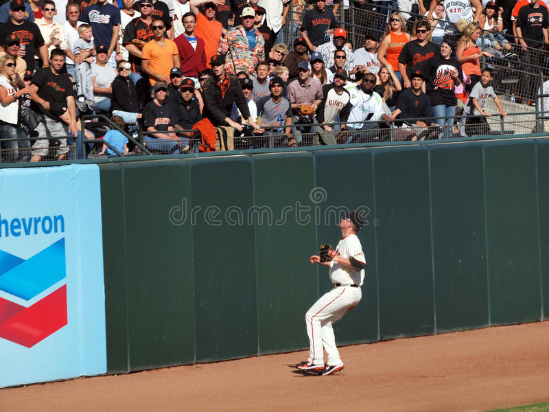 Aubrey Huff Watches a home run fly over his head. San Francisco Giants Vs. Florida Marlins: Giants left fielder Aubrey Huff Watches a home run fly over his head royalty free stock images