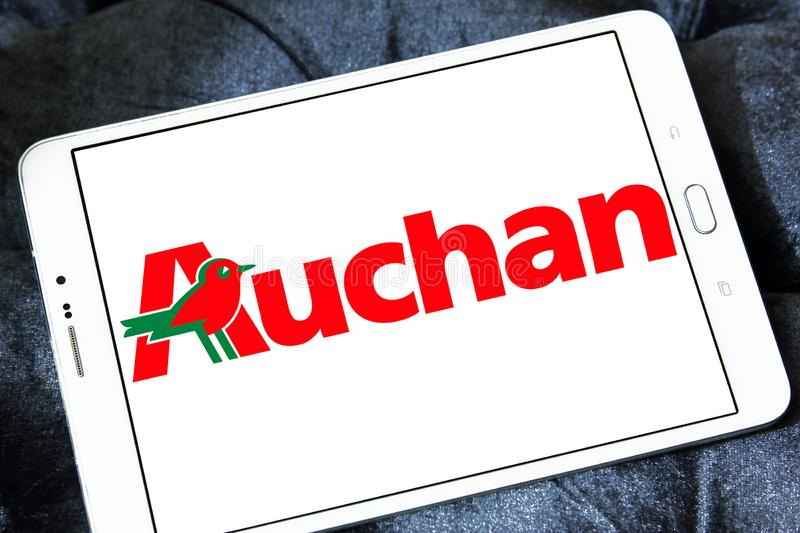 Auchan retail group logo. Logo of Auchan retailer on samsung tablet . Auchan is a French international retail group and multinational corporation stock image