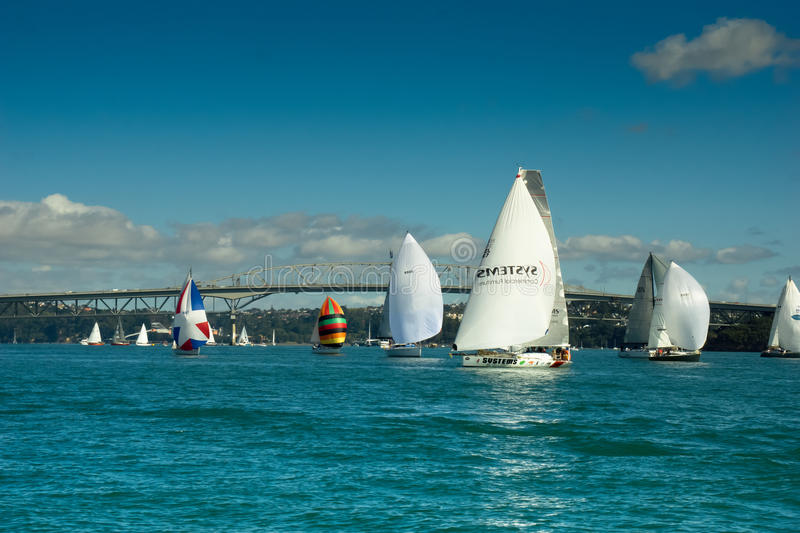 Auckland - The City of Sails. Auckland skyline with yacht sails in the foreground. Set under blue sky the city in the centre of the Waitemata harbour is in the royalty free stock photography