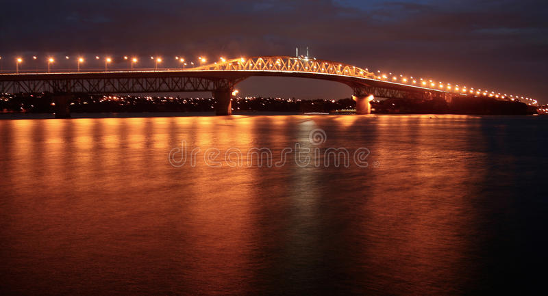 Auckland Harbor Bridge at night stock photography