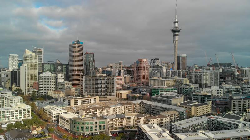 AUCKLAND, NEW ZEALAND - AUGUST 26, 2018: Aerial view of cityscape at sunset. More than 1 million tourists visit Auckland annually stock image