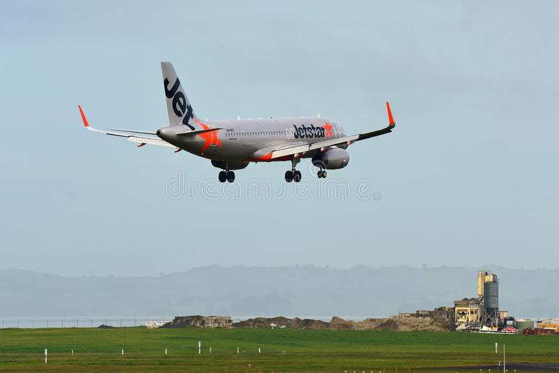 Jetstar Airways Airbus A320 landing at Auckland International Airport. AUCKLAND, NEW ZEALAND - JULY 10: Jetstar Airways Airbus A320 landing at Auckland royalty free stock photo