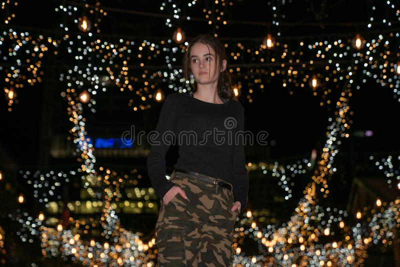 Auckland`s Britomart area. AUCKLAND, NEW ZEALAND - SEPTEMBER 14 2018; Young woman surrounded by decorative fairy lights.in Auckland`s Britomart area bright and royalty free stock photos