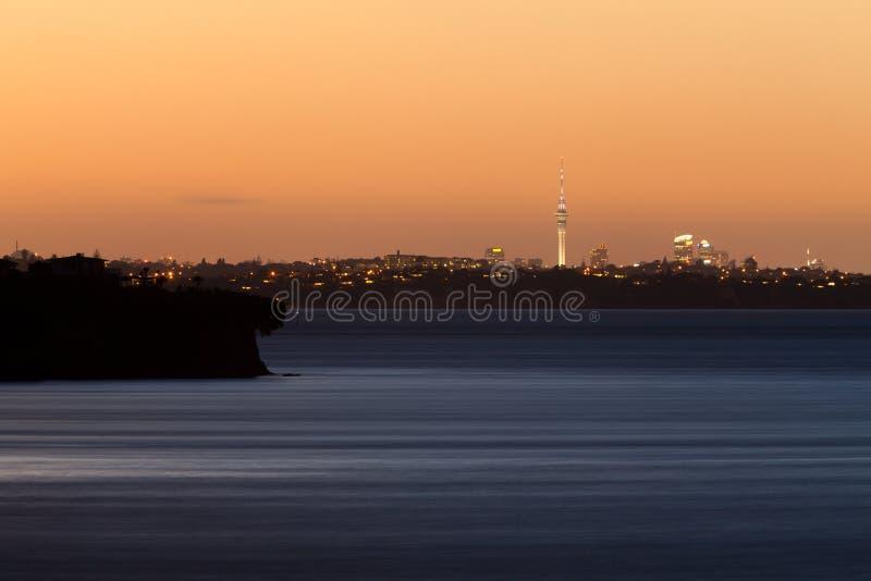 Auckland NZ distant citylight skyline after sunset stock photo