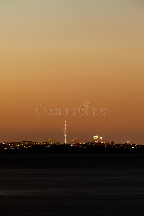 Auckland NZ distant citylight skyline after sunset royalty free stock image