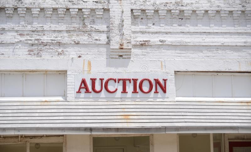 Auction and Bidding Clearinghouse. An auction is a process of buying and selling goods or services by offering them up for bid, taking bids, and then selling the stock image