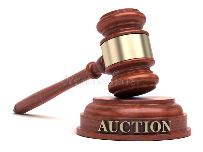 Auction bidding. Gavel and Auction text on sound block royalty free stock photo