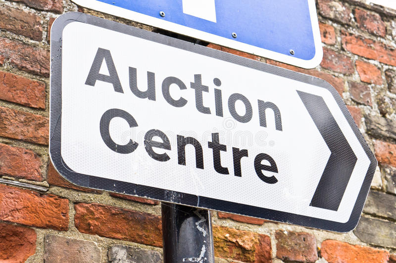 Auction centre. Sign for an auction centre in a UK town royalty free stock photo