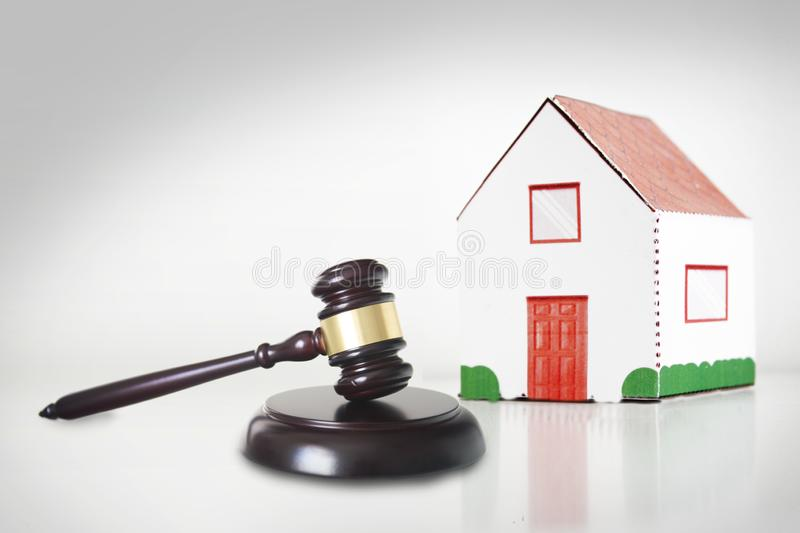 Auction or Judgment hammer for a real state case against a white background. Empty copy space stock photography